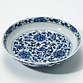 A <b>blue</b> and white 'Lotus' dish, Kangxi six-character mark in underglaze <b>blue</b> within a double circle and of the period (1662-1722)