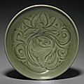 A carved Yaozhou '<b>Lotus</b>' dish, Northern Song-Jin dynasty, 12th-13th century