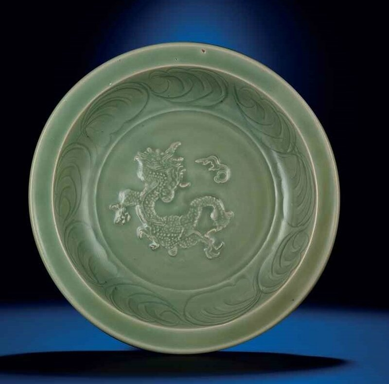 A Longquan celadon carved and sprig moulded 'Dragon' dish, Ming dynasty, 14th century