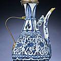 A very rare gilt-metal-mounted <b>blue</b> and white octagonal ewer, Yuan dynasty (1279-1368)
