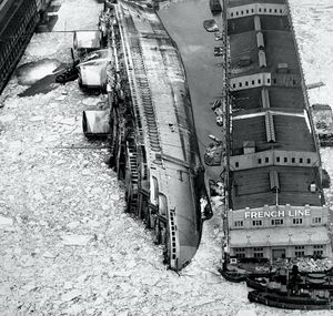 NEW YORK DAILY NEWS The former French luxury liner Normandie lies on its side following 1942 blaze