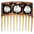 An Art Nouveau horn, natural pearl and diamond hair <b>comb</b>, by Lalique