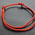 Bracelet en fil rouge du Medium Marabout voyant DAZODJI