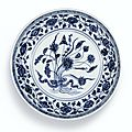 A blue and white '<b>Lotus</b> Bouquet' dish, Ming dynasty, Yongle period