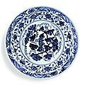 A superb <b>blue</b> and white 'grape' charger, Ming Dynasty, Yongle period (1403-1425)