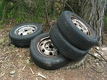 220px-Tires_in_forest