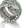 A fine 18 carat white gold, emerald and diamond 'serpenti' watch bangle, by <b>Bulgari</b>