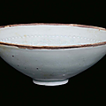 A <b>blue</b> earthenware bowl with vegetables and children decorations, China, Song Dynasty (960-1279)