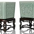 A fine and rare pair of celadon-glazed <b>lotus</b> porcelain jardinières on wood stands, China, Qianlong seal marks and period