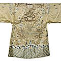 A beige-ground gold-<b>thread</b> and silk embroidered dragon robe for a religious statue, China, 19th century