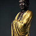 A finely cast parcel-gilt <b>bronze</b> figure of Damo, Ming dynasty, 16th century