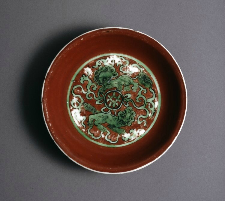 Porcelain Lion dogs dish with green enamel reserved on a red ground, Ming dynasty, Jiajing mark and period (1522-1566)
