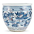 A blue and white and underglazed-red 'crane and <b>lotus</b>' fish jar, Qing dynasty, 18th – 19th century