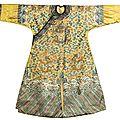 A rare yellow embroidered twelve-<b>symbol</b> semi-formal 'dragon' robe, Qing dynasty, 19th century