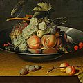 Circle of Louise Moillon (c.1610 Paris 1696), <b>A</b> still life with peaches and grapes, in <b>a</b> bowl, on <b>a</b> <b>table</b>.
