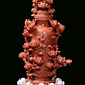 A red coral <b>sculpture</b> representing a vase with floral shoots, China, Qing Dynasty, 19th century