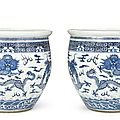 A large pair of blue and white '<b>Dragon</b>' jardinières, Qing dynasty, 19th century
