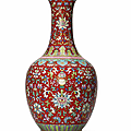 A rare pair of coral-red ground <b>famille</b> <b>rose</b> vases, Jiaqing six-character seal mark in iron-red and of the period (1796-1820)