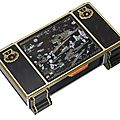A rare Art <b>Deco</b> lacquer and gem-set cigarette box, by Cartier