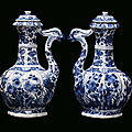 A pair of white and blue porcelain <b>ewers</b>, China, Qing Dynasy, Kangxi Period (1662-1722)