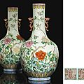 A superb pair of famille rose vases, Jiaqing <b>iron</b>-red six-character seal marks and of the period (1796-1820)