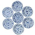 A set of seven <b>blue</b> and white fluted 'Sea creatures' dishes, Kangxi period (1662-1722)