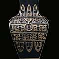 A porcelain vase bronze and gold imitation with relief archaic decoration, China, Qing Dynasty, <b>19th</b> <b>century</b>
