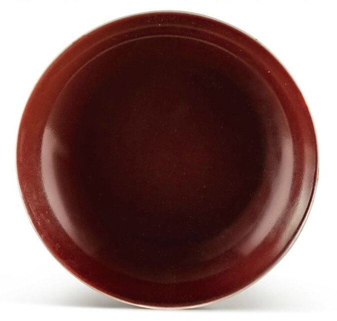 A red-glazed dish, Seal mark and period of Qianlong (1736-1795)