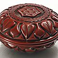A carved circular cinnabar lacquer '<b>Lotus</b>' box and cover, Ming dynasty, late 14th-15th century