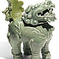 A Japanese green-glazed '<b>lion</b>' incense burner and cover, 19th Century