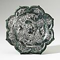 A bronze '<b>Birds</b> and Flowers' octafoil mirror, Tang Dynasty