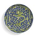 A fine <b>blue</b>-ground and yellow-enameled 'dragon' dish, Kangxi mark and period (1662-1722)