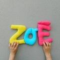 Zoé, Alex, Fiona, Imran, des prénoms en boudins de coussins?
