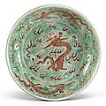 A rare green-ground and <b>iron</b>-red 'Dragon' dish, Kangxi mark and period (1662-1722)