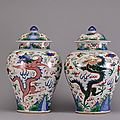 A pair of large wucai <b>dragon</b> jars, Transitional period-Early Qing Dynasty