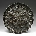 Carved black lacquerware eight-lobed dish, Late Yuan <b>to</b> early Ming dynasty, second half of the 14th century