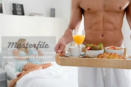 614-01433100em-Man-with-breakfast-tray