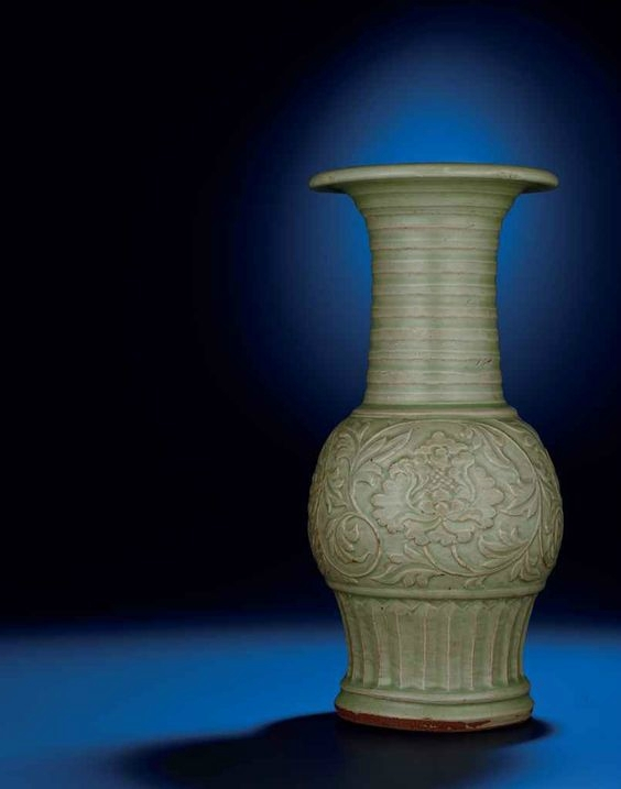 A rare Longquan celadon moulded trumpet-necked baluster vase, Yuan-Ming dynasty, 14th century