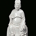 A Blanc de Chine porcelain sitting Dignitary, China, Dehua, Qing Dynasty, <b>18th</b> <b>century</b>