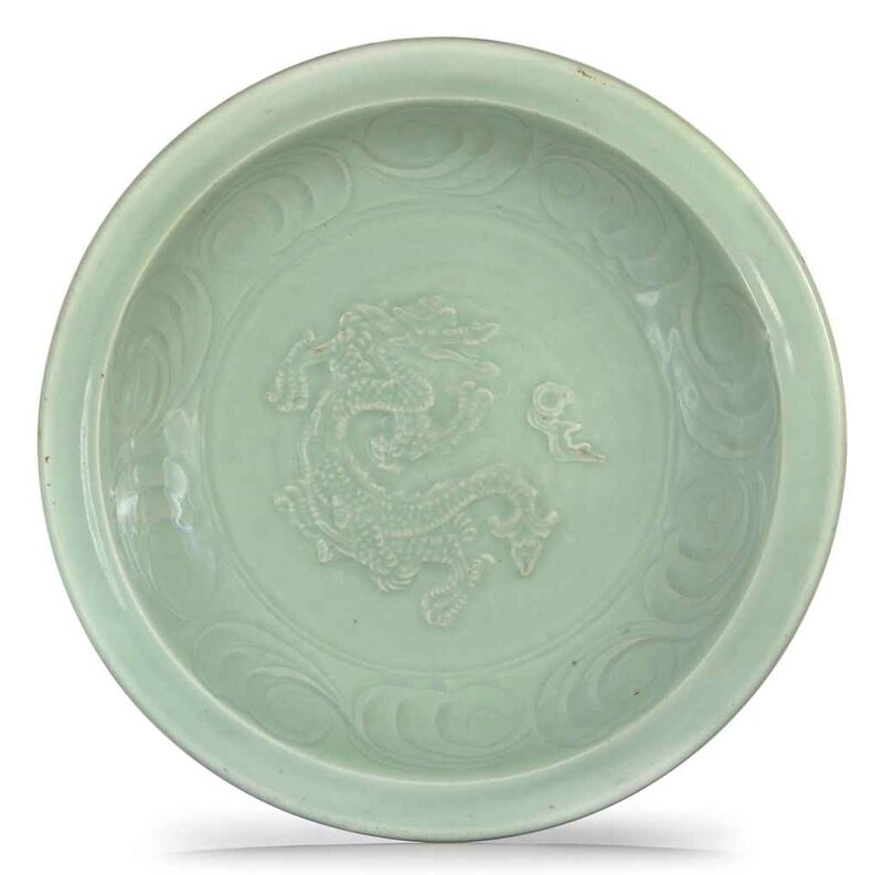 A Longquan celadon carved and moulded 'Dragon' dish, Yuan dynasty, 13th-14th century