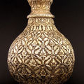 An Exceptional Large Chased Silver-Gilt <b>Lidded</b> <b>Vase</b>, silver, India, 18th-19th c