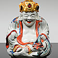 A porcelain figure of hotei seated, japan, edo period, late 17th/early 18th century with a gilt-bronze mount, german, circa 1740