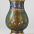 A small <b>cloisonné</b> <b>enamel</b> pear-shaped vase, Hu, Qianlong four-character mark cast in relief within a square and of the period
