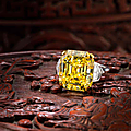 An important fancy coloured diamond and diamond ring