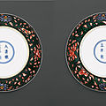 A pair of black-ground <b>famille</b>-<b>verte</b> dishes, marks and period of Yongzheng (1723-1735)