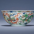 A fine and extremely rarewucai'Dragon and Phoenix' bowl, Yongzheng six-character mark in underglaze blue within a double circle and of the period (1723-1735)