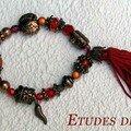 bracelet cuivré orange à pompon