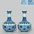 A pair of ming-style blue and white bottle vases, daoguang six-character seal marks in underglaze blue and of the period (1821-1