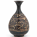 A fine and rare Cizhou carved pear-shaped vase, yuhuchunping, Jin Dynasty