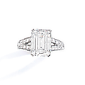 A <b>diamond</b> <b>and</b> <b>platinum</b> <b>ring</b> by Boucheron set with an emerald-cut <b>diamond</b> weighing 5,25 cts